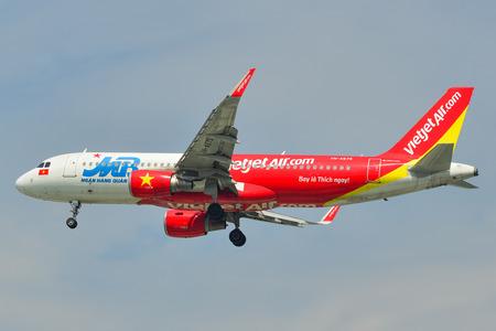 Saigon, Vietnam - Jan 26, 2019. An Airbus A320 airplane of Vietjet Air landing at Tan Son Nhat Airport (SGN) in Saigon (Ho Chi Minh City), Vietnam.