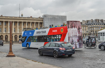 Paris, France - Oct 3, 2018. Sightseeing bus at La Concorde Square in Paris city, France. Paris is a global center for art, fashion, gastronomy and culture.