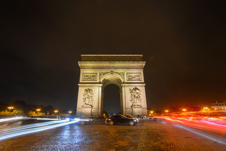 The Triumphal Arch at evening in Paris, France. Arc de Triomphe was inaugurated in 1836 by French king, Louis-Philippe. Reklamní fotografie