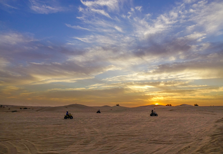Riding quadbike on the Dubai desert. Riding Quad Bike is a memorable experience when visiting Dubai. Stockfoto