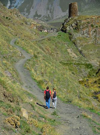 Trekkers walking on the trail of Kazbegi, Georgia. Kazbegi is a mountain in the Caucasus (Kavkaz) Range.