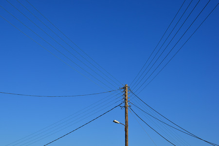 Wire electric pylon under blue sky in sunny day. Stock Photo