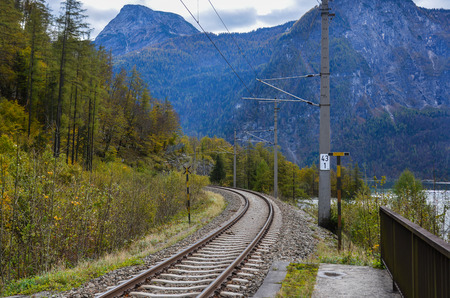Empty railway tracks at sunny day in Hallstatt, Austria.
