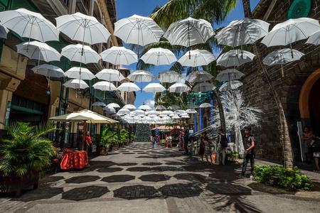 Port Louis, Mauritius - Jan 4, 2017. White umbrellas urban street decoration of Old Town in Port Louis, Mauritius.