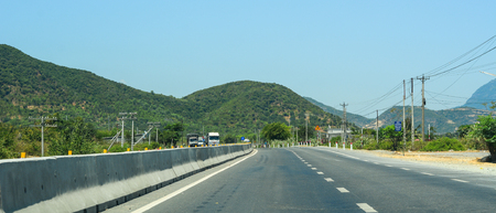 Nha Trang, Vietnam - Mar 20, 2016. Highway at summer day in Nha Trang, Vietnam. The total length of the Vietnam road system is about 222,179 km. Banco de Imagens - 120170438