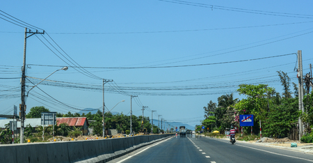 Nha Trang, Vietnam - Mar 20, 2016. Highway at summer day in Nha Trang, Vietnam. The total length of the Vietnam road system is about 222,179 km. Banco de Imagens - 120171676