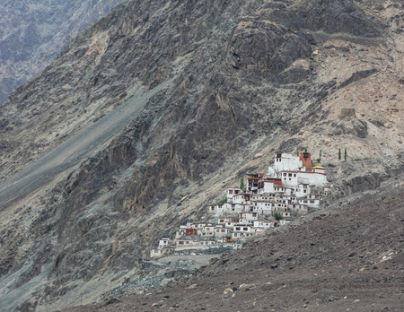 Ancient Tibetan temple on mountain in Ladakh, North of India. Ladakh is renowned for its remote mountain beauty and culture.