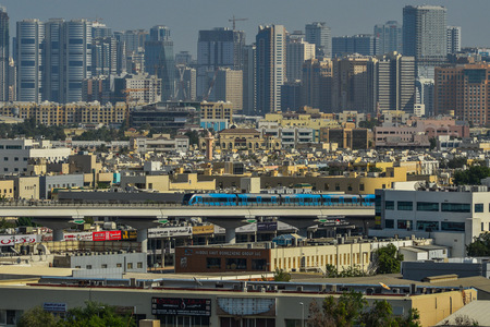 Dubai, UAE - Dec 9, 2018. Cityscape with modern buildings and metro train in Dubai, UAE.