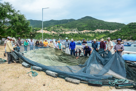 Phan Rang, Vietnam - Jan 27, 2016. Fishermen working with fishing nets in Vinh Hy Bay, Phan Rang, Vietnam. Phan Rang is one of famous destinations in southern Vietnam.