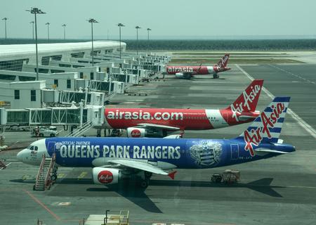 Kuala Lumpur, Malaysia - Apr 13, 2016. AirAsia airplanes docking at Kuala Lumpur Airport (KLIA). KLIA is the world 23rd-busiest airport by total passenger traffic. Editorial