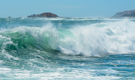 Huge wave on the blue sea at sunny day in Southern Vietnam.