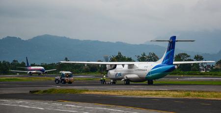 Kuala Lumpur, Malaysia - Apr 13, 2016. Garuda airplane docking at Kuala Lumpur Airport (KLIA). KLIA is the world 23rd-busiest airport by total passenger traffic. Editorial