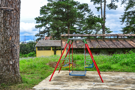 Empty chain swings in children playground outdoors in Dalat, Vietnam.