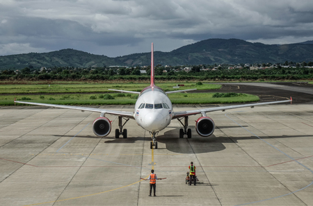 Dalat, Vietnam - Sep 15, 2018. An Airbus A320 airplane of Vietjet Air docking at Lien Khuong Airport (DLI) in Dalat, Vietnam.