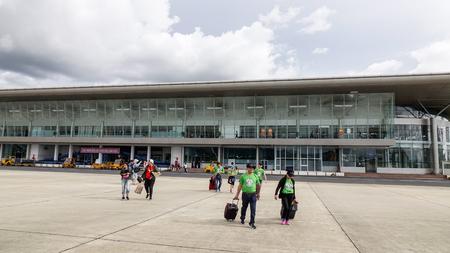 Dalat, Vietnam - Sep 15, 2018. Passengers walking on airfield for boarding at Lien Khuong Airport (DLI) in Dalat, Vietnam. Stock fotó