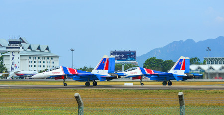 Langkawi, Malaysia - Mar 30, 2019. Su-30SM fighter jets belonging to the Russian Knights aerobatic demonstration team taxiing on runway of Langkawi Airport (LGK). Stock Photo