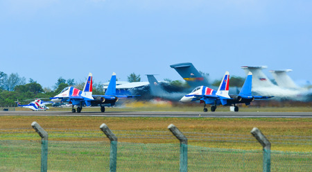 Langkawi, Malaysia - Mar 30, 2019. Su-30SM fighter jets belonging to the Russian Knights aerobatic demonstration team taxiing on runway of Langkawi Airport (LGK). Banco de Imagens