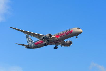 Phuket, Thailand - Apr 4, 2019. A Boeing 787-9 Dreamliner of Etihad (A6-BLV Abu Dhabi Grand Prix) landing at Phuket Airport (HKT).
