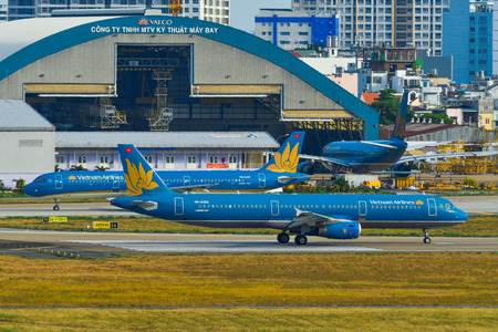 Saigon, Vietnam - Apr 23, 2019. Passenger airplanes taxiing on runway of Tan Son Nhat Airport (SGN).