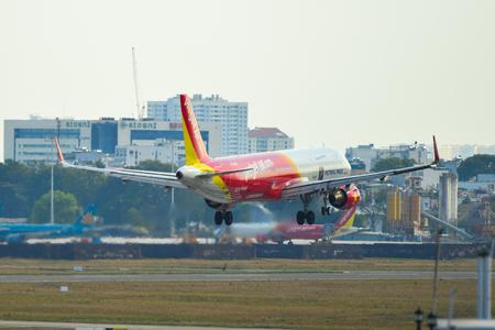 Saigon, Vietnam - Apr 23, 2019. An Airbus A321 airplane of Vietjet Air (VN-A667) landing at Tan Son Nhat Airport (SGN).
