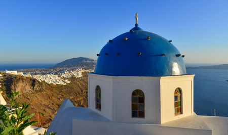 Ancient Greek Orthodox church on Santorini Island. Santorini is one of the most popular islands in the world. Imagens