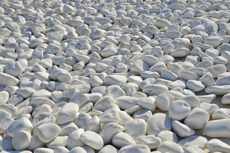 White stones pebbles for decoration at luxury sea view resort on Santorini Island, Greece.