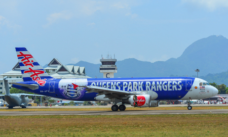 Langkawi, Malaysia - Mar 30, 2019. An Airbus A320 airplane of AirAsia (9M-AFV Queens Park Rangers) taxiing on runway of Langkawi Airport (LGK).