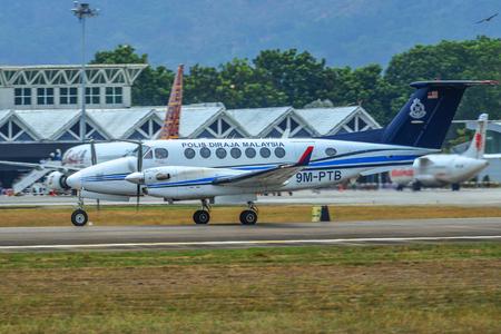 Langkawi, Malaysia - Mar 30, 2019. A Beechcraft 350 Super King Air airplane of Royal Malaysian Police (9M-PTB) taxiing on runway of Langkawi Airport (LGK).