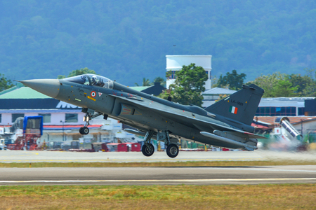 Langkawi, Malaysia - Mar 30, 2019. India Air Fore HAL Tejas fighter jet taking off from Langkawi Airport (LGK). Redakční