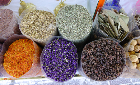 Variety of spices and herbs on the Arab street market stall.
