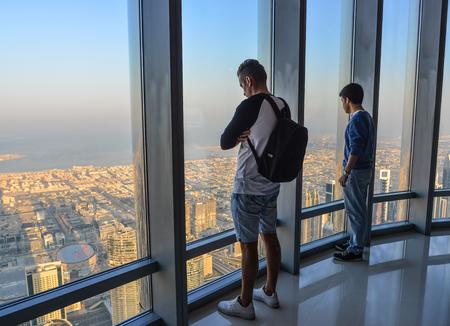 Dubai, UAE - Dec 7, 2018. People enjoying at the observation deck of the highest building in the world, Burj al Khalifa.