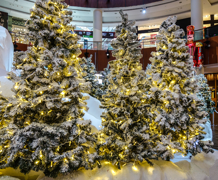 Dubai, UAE - Dec 7, 2018. Christmas tree in a shopping mall at Dubai Mall. The Mall is an epicentre of luxury shops for the finest shopping in Dubai (UAE).