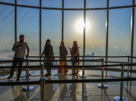 Dubai, UAE - Dec 7, 2018. People enjoying at the observation deck of the highest building in the world, Burj al Khalifa. Editorial