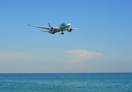 Phuket, Thailand - Apr 4, 2019. TUI Airways Boeing 787-9 Dreamliner (G-TUIJ) landing above the sand beach near Phuket Airport (HKT).