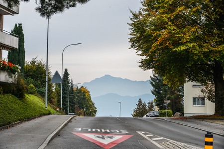 Lucerne, Switzerland - Oct 23, 2018. Rural road at summer day in Luzern, Switzerland. Luzern is home to many peaceful countryside scenes.