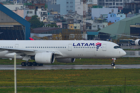 Saigon, Vietnam - May 3, 2019. A7-AMB Latam Brasil Airbus A350-900 taxiing to take off from Tan Son Nhat Airport (SGN) in rainy day. Sajtókép