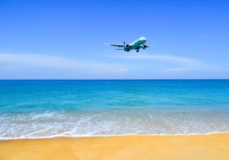 Phuket, Thailand - Apr 4, 2019. Boeing 777-300ER Thai Airways HS-TKO landing above the sand beach near Phuket Airport (HKT).