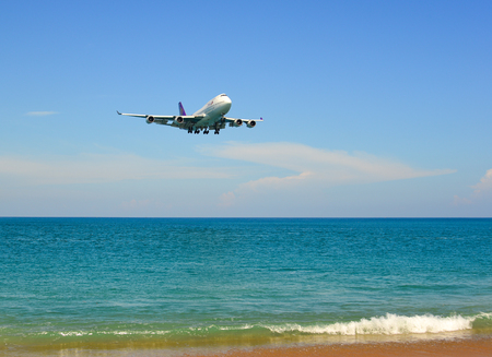 Phuket, Thailand - Apr 4, 2019. HS-TGB Thai Airways International Boeing 747-400 landing above the sand beach near Phuket Airport (HKT).