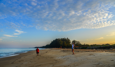 Phuket, Thailand - Apr 4, 2019. People enjoying on Naiyang Beach at sunny day on Phuket Island, Thailand.