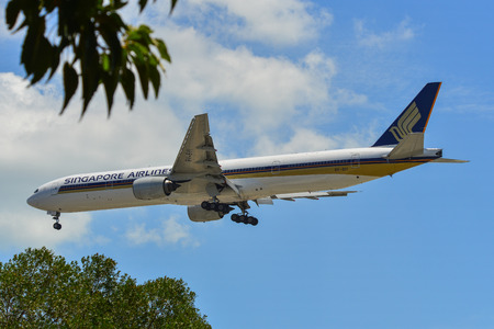 Singapore - Mar 27, 2019. 9V-SYI Singapore Airlines Boeing 777-300 landing at Changi Airport (SIN). Changi is currently rated the World Best Airport by Skytrax (2018).