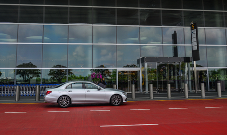 Singapore - Mar 28, 2019. A car waiting at Terminal 4 of Singapore Changi Airport (SIN). Terminal 4 officially opened on October 2017.