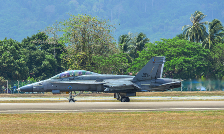 Langkawi, Malaysia - Mar 30, 2019. Boeing FA-18D Hornet of Royal Malaysian Air Force (reg. M45-07) taxiing on runway of Langkawi Airport (LGK). Editorial