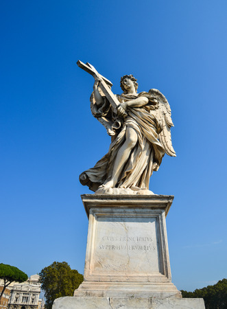 Rome, Italy - Oct 14, 2018. Angel statue along Sant Angelo bridge. Ponte Sant Angelo is a Roman bridge in Rome, completed in 134 AD.