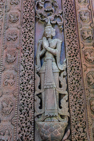 Bas-reliefs on the wall of ancient temple in Mandalay, Myanmar.