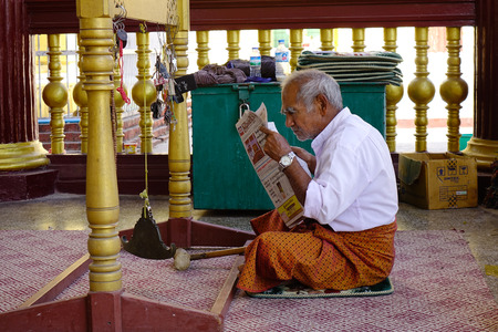 Yangon, Myanmar - Feb 9, 2017. An old man reading news on the morning. Myanmar ranked 174th out of 178 in its 2010 Press Freedom Index.