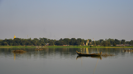 Landscape of Lake Taungthaman (Burma). Tourists like to watch the tranquility and serenity of this beautiful lake.