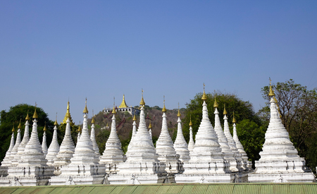 View of Kuthodaw Pagoda in Mandalay, Myanmar. The pagoda contains 729 marble slabs inscribed with Buddhist teachings. Stock fotó