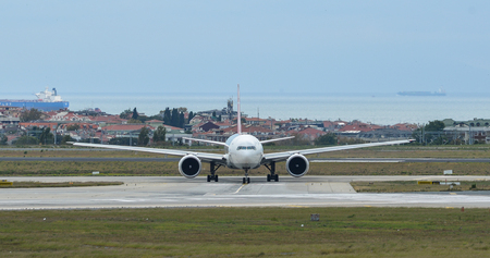 Passenger airplane taxiing on runway of Istanbul Ataturk Airport (IST).