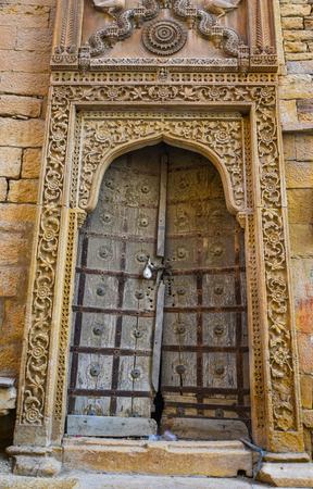 Wooden door of ancient building in Jaipur, India. Stock Photo