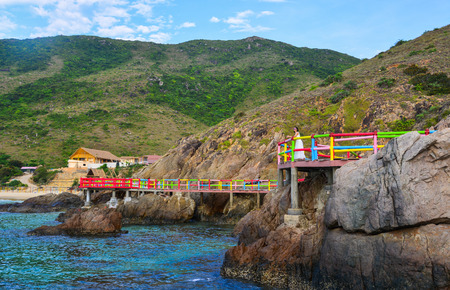 Colorful brigde for tourists on the sea in Quy Nhon, Vietnam.